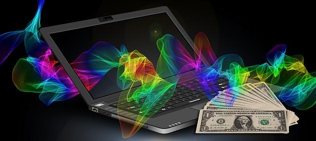 パソコンでブログ収入で得たドル札の画像