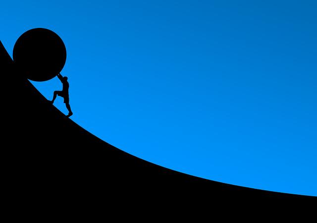 崖から落ちそうな大きな石を止めている人のシルエットのイラスト画像