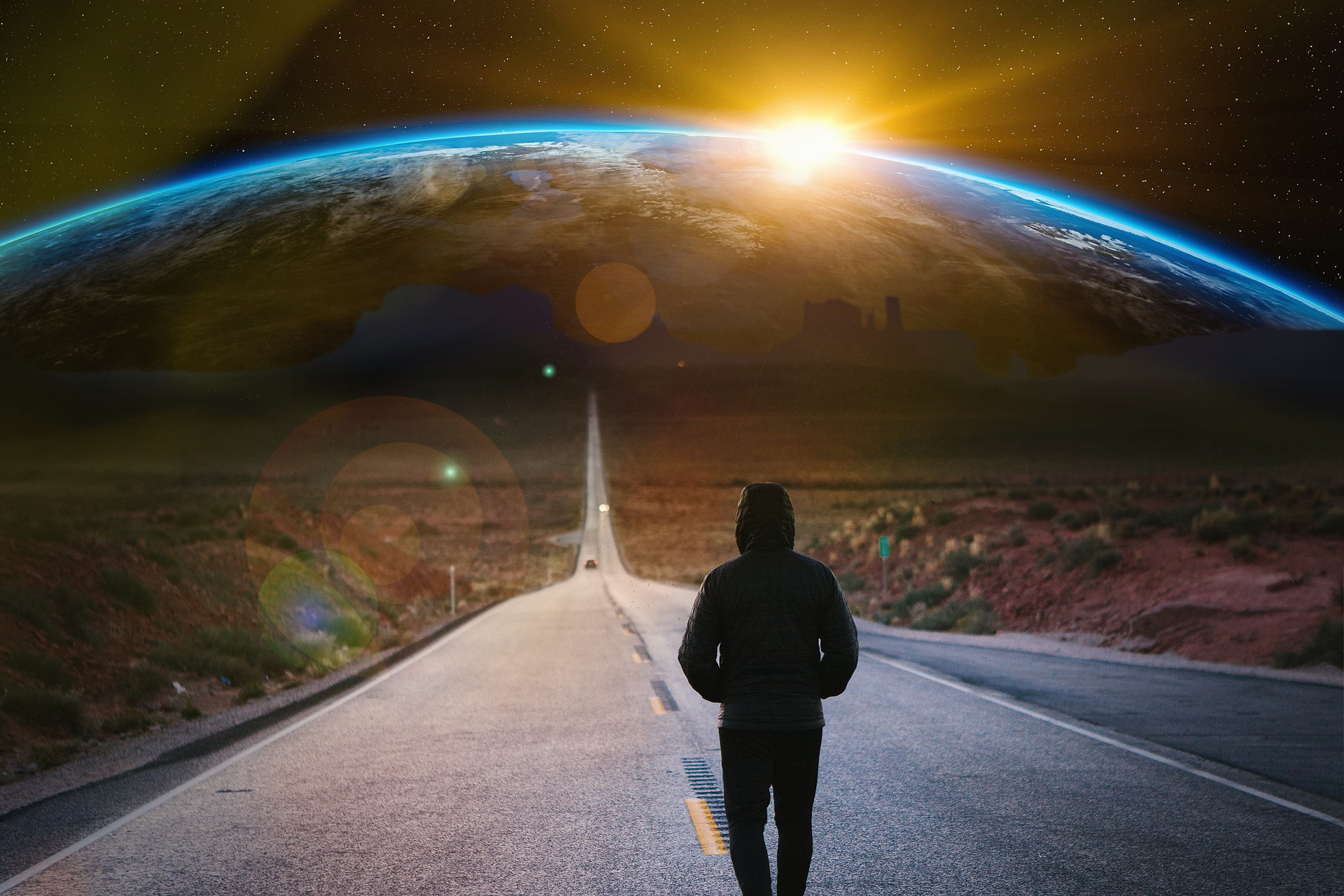 30代で無職になった男が地球に向かって果てしなく歩いているイメージ画像